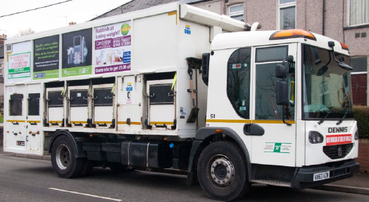 Council recycling vehicle displaying advertising