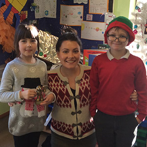 Miss Grimas is pictured with Kayleigh Rudge and Andrew Morgan