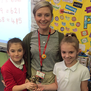 Garnteg Primary School - Miss Jones, Lois, Demi Mai and the class trophy